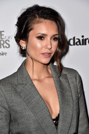 Nina Dobrev kept it chic with a side-parted messy updo at the Marie Claire's Image Maker Awards.