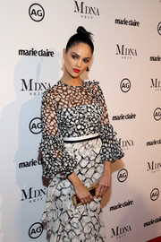 Eiza Gonzalez carried an elegant gold clutch by Lee Savage at the 2018 Image Makers Awards.