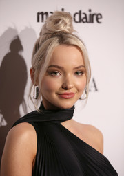 Dove Cameron styled her hair into a top knot with face-framing tendrils for the 2018 Image Makers Awards.