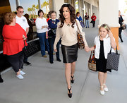 Marie Osmond debuted her collection, and her legs for that matter, in this amazing leather skirt.