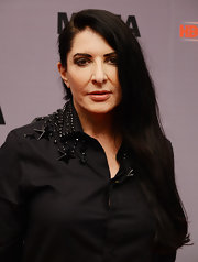 Marina Abramovic swept her long black hair to the side for a simple-yet-dramatic feel.