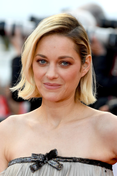 Marion Cotillard Short Side Part [sink or swim,hair,beauty,blond,hairstyle,human hair color,eyebrow,lady,chin,fashion model,long hair,red carpet arrivals,marion cotillard,screening,cannes,france,cannes film festival,palais des festivals]