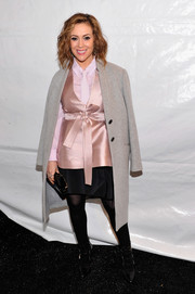 Alyssa Milano added some warmth to her outfit with a gray wool coat during the Marissa Webb fashion show.