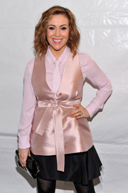 Alyssa Milano made menswear look so feminine with this pink silk vest, white button-down, and tie combo at the Marissa Webb fashion show.