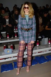 Nicola Roberts was mad about plaid at the Mark Fast show in a belted purple and green blazer and contrasting slacks.