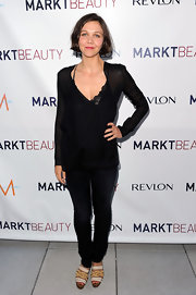 Maggie showed off her sheer blouse while walking the red carpet at the Markbeauty launch.