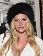 Kesha was winter-chic in a black fur hat while attending the 'Bowie Unseen' exhibition.