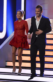 Rafael Van Der Vaart appeared on the 'Wetten dass...?' show looking dapper in a black suit and white button-down shirt.l