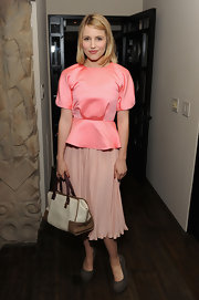 Dianna Agron attended the launch of Marni's new range wearing this gorgeous H&M peplum top in pink.