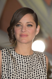 Marion Cotillard looked sweet and elegant with her side-swept curls at the Marrakech International Film Festival.
