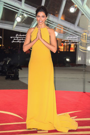 Deepika Padukone was all about simple sophistication in a mustard evening dress by Gauri and Nainika at the Marrakech International Film Festival.
