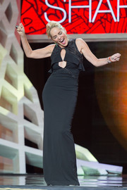 Sharon Stone was all about curves and cleavage at the Marrakech International Film Festival in a tight-fitting black Roberto Cavalli dress with a revealing keyhole neckline.