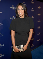 Rosario Dawson sported a monochrome look during the Martell Caractere launch with this black-and-white leather clutch and LBD combo.