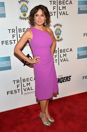 Jennifer Grey stepped onto the red carpet at 'The Avengers' premiere wearing sexy metallic gold heels.