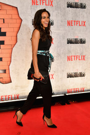 Rosario Dawson paired a black hand-strap clutch by Vince Camuto with a sleeveless jumpsuit for the New York premiere of 'The Defenders.'