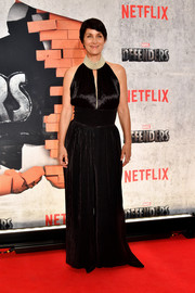 Carrie-Anne Moss chose a shiny black halter jumpsuit for the New York premiere of 'The Defenders.'