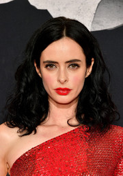 Krysten Ritter accentuated her pout with a swipe of bright red lipstick.