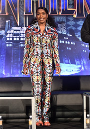 Angela Bassett looked exuberant in this printed pantsuit by Dent De Man at the 'Black Panther' global junket press conference.
