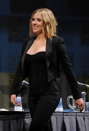 Scarlet wore a slimming, corset top under a cropped blazer.