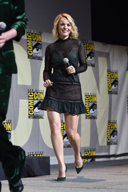 Rachel McAdams teamed her dress with green suede pumps by Jimmy Choo.