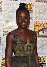 Lupita Nyong'o swept her hair up into a braided top knot for the Marvel Studios panel during Comic-Con.