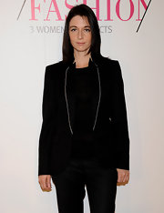 A tailored black jacket with white lapel piping pulled Mary's smart press conference look together nicely.