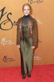 AnnaSophia Robb toughened up her dress with a brown suede jacket.