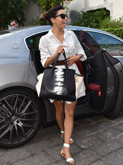 Eva Longoria arrived for the Taormina Film Festival looking casual in Yosi Samra flat sandals and a white button-down.