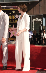 Anne Hathaway opted for a white MaxMara pantsuit, featuring oversized trousers and a cropped jacket, when she attended Matthew McConaughey's Walk of Fame ceremony.