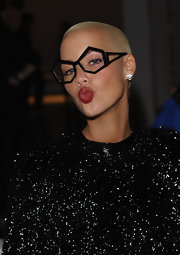 Amber Rose showed off her sultry red lips while attending the Mathew Williamson fashion show.