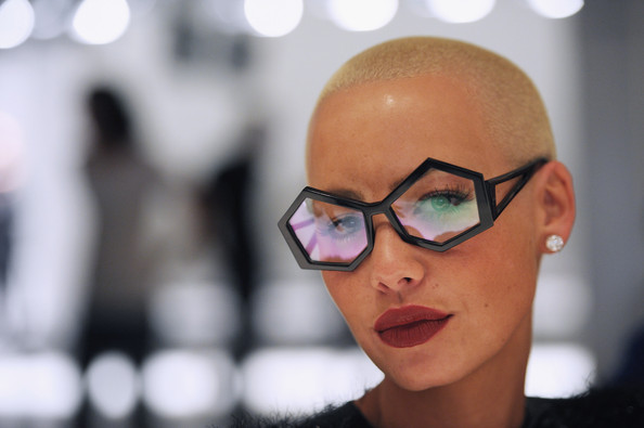 Amber Rose showed off her round sunglasses while hitting fashion week.