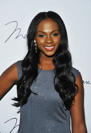 Tika Sumpter looked lovely at the Max Azria fashion show with this romantic wavy 'do.