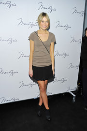 Katrina donned a pleated mini with a tee at the Max Azria Fashion Show.