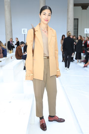 Caroline Issa posed at the Max Mara Fall 2020 show wearing a camel-colored blazer.