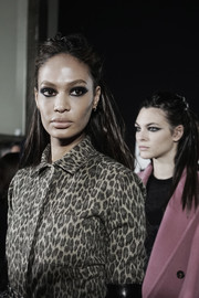 Joan Smalls walked the Max Mara fashion show wearing her hair in a messy half-up style.