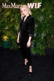 Pom Klementieff styled her jumpsuit with black fur sandals.