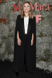 Olivia Wilde made a dramatic entrance in a long black cape at the InStyle Max Mara Women in Film celebration.