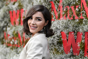 Olivia Culpo looked adorable with her curly bob at the InStyle Max Mara Women in Film celebration.