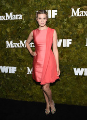 Maggie Grace attended the Women in Film Face of the Future Award looking sweet in a coral Max Mara cocktail dress accented with draped fabric down one side.