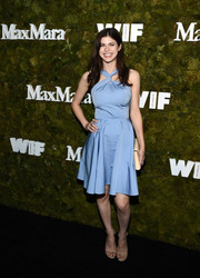 Alexandra Daddario went the ultra-girly route in a pastel-blue Max Mara dress, featuring a crisscross neckline and a fit-and-flare silhouette, during the Women in Film Face of the Future Award.