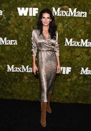 Angie Harmon was classic in a shiny gold wrap dress by Max Mara at the Women in Film Face of the Future Award.