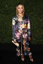 Kat Graham amped up the girly appeal, pairing her blouse with matching floral pants.