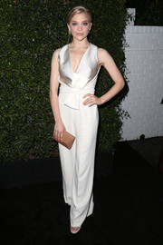 Natalie Dormer cut a sleek figure in a Max Mara satin silver and white jumpsuit at the 2016 Women in Film Max Mara Face of the Future event.