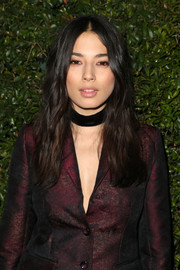 Jessica Gomes wore her locks down with a center part and barely-there waves at the Max Mara Face of the Future event.