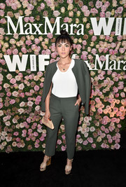 Isabelle Fuhrman styled her suit with a pair of nude wedges.