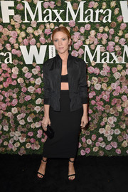 Brittany Snow completed her all-black outfit with a midi pencil skirt, also by Max Mara.