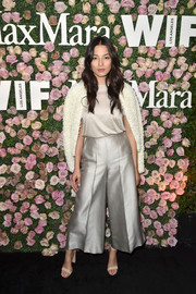 Jessica Gomes looked effortlessly stylish in gold Max Mara wide-leg pants and a matching shirt at the 2017 Face of the Future event.