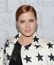 Amy Adams styled her hair into a sleek, elegant low ponytail for the Max Mara accessories campaign celebration.