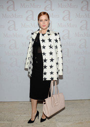 Amy Adams arrived for the Max Mara accessories campaign celebration wearing a black-and-white star-print coat from the label.