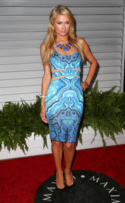 Paris Hilton chose a body-con blue asymmetrical-print dress with sheer midriff cutouts for the Maxim Hot 100 event.